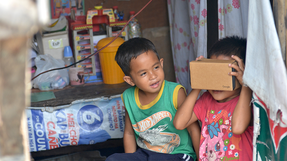 philippines children using VR goggles